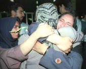 An Iranian passenger of the Boeing 707 of the private Kish Air airliner hijacked 19 September to Israel is greeted by relatives upon her arrival in...