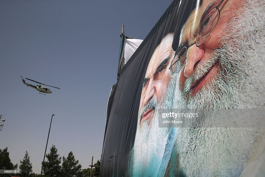 An Iranian police helicopter passes above portraits of Iran's supreme leader Ayatollah Ali Khamenei (R) and the former Ayatollah Khomeini outside Khomeini's shrine on the 25th anniversary of his death on June 4, 2014 on the outskirts of Tehran, Iran. Khomeini, the founder of the Islamic Republic, is still revered by many Iranians, and his portrait hangs throughout the country.