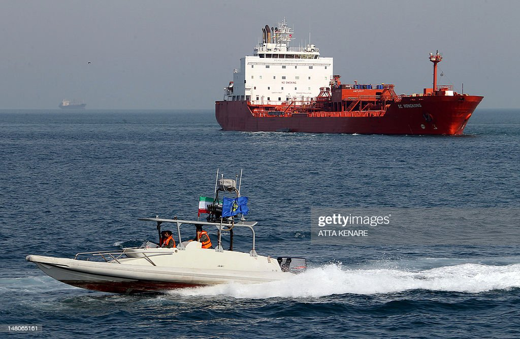 An Iranian Revolutionary Guard speedboat cruises past an oil tanker off the port of Bandar Abbas, southern Iran, on July 2, 2012. Iran has come up with several methods to foil the European insurance embargo on ships loaded with its crude, a sanction which may harm its vital exports as much as the EU oil embargo itself.