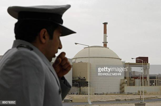 An Iranian security guard stands outside the building housing the reactor of Bushehr nuclear power plant at the Iranian port town of Bushehr 1200 Kms...