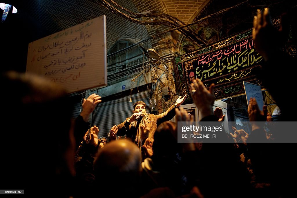 An Iranian Shiite Muslim panegyrist sings religious songs at Tehran's Grand Bazaar, on January 3, 2013 during the Arbaeen religious festival which marks the 40th day after Ashura, commemorating the seventh century killing of Prophet Mohammed's grandson, Imam Hussein.