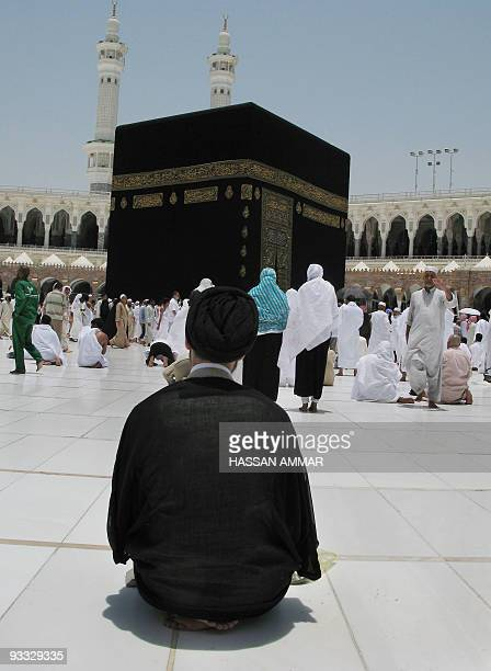 An Iranian Shiite Muslim pilgrim prays in front of the Kaaba inside Mecca's Grand Mosque Islam's holiest shrine on June 05 2008 King Abdullah of...