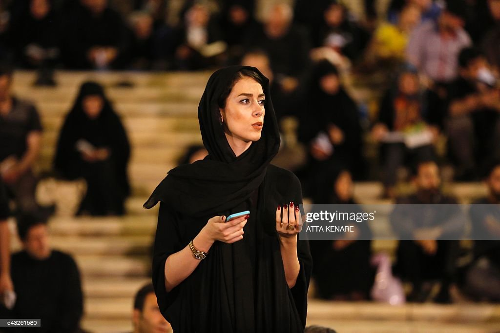 An Iranian Shiite Muslim woman prays at the Imam Khomeini grand mosque in the capital Tehran in the early hours of July 27, 2016 in commemoration of the death of the seventh century Imam Ali bin Abi-Taleb and in preparation for Laylat al-Qadr -- a high point during Ramadan when the Koran, Islam's holy book, was revealed to Prophet Mohammed by archangel Gabriel. Imam Ali is the first Shiite Imam and fourth caliph to succeed Prophet Mohammed, his cousin and father-in-law. / AFP / ATTA