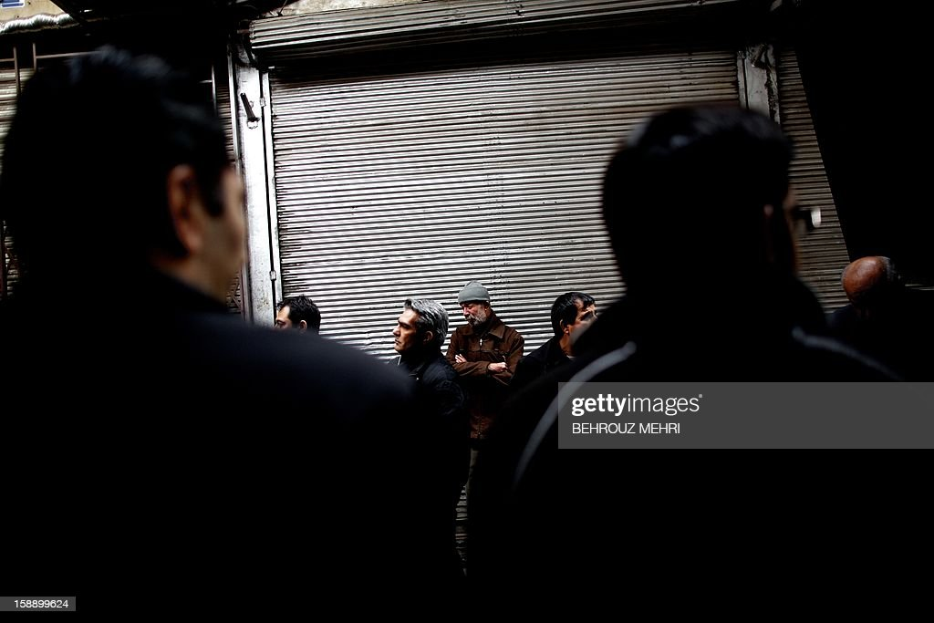 An Iranian Shiite Muslims attend the Arbaeen religious festival at Tehran's Grand Bazaar, on January 3, 2013 to mark the 40th day after Ashura, commemorating the seventh century killing of Prophet Mohammed's grandson, Imam Hussein. AFP PHOTO/BEHROUZ MEHRI