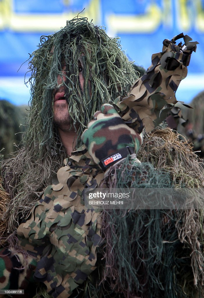 An Iranian soldier in full camouflage marches during the Army Day parade in Tehran on April 18, 2010. President Mahmoud Ahmadinejad said that Israel was on its way to collapse, as Iran's military displayed a range of home-built drones and missiles at the annual Army Day parade.