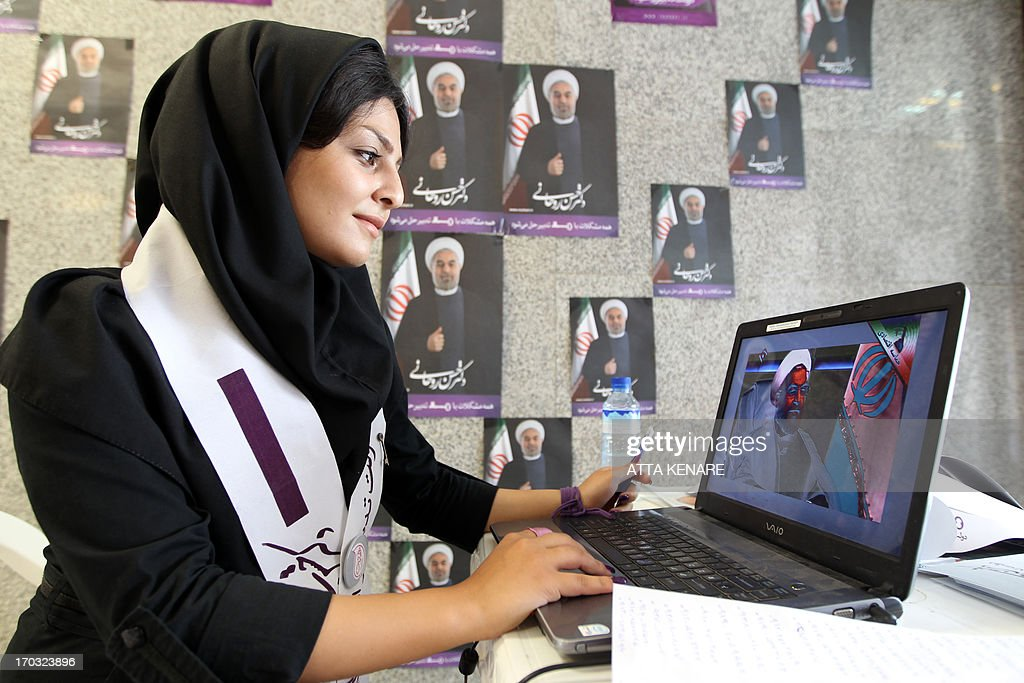 An Iranian supporter of Hassan Rowhani, moderate presidential candidate and former top nuclear negotiator, works on her laptop in one of his campaign offices in Tehran on June 11, 2013. Iran elects on June 14, 2013 a successor to President Mahmoud Ahmadinejad, whose eight years in office have been marked by stiff Western sanctions over Tehran's controversial nuclear drive and the economic turmoil they have caused.