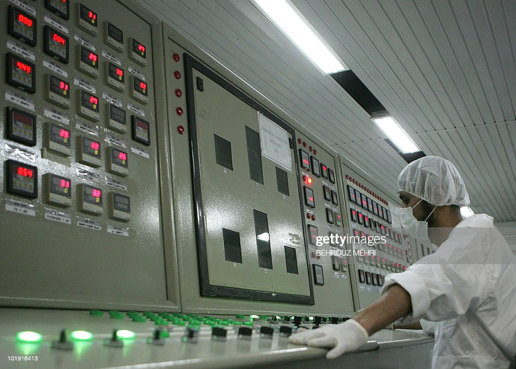 An Iranian technician works at the control room of the Isfahan Uranium Conversion Facilities 420 kms south of Tehran 03 February 2007 Iran opened the...