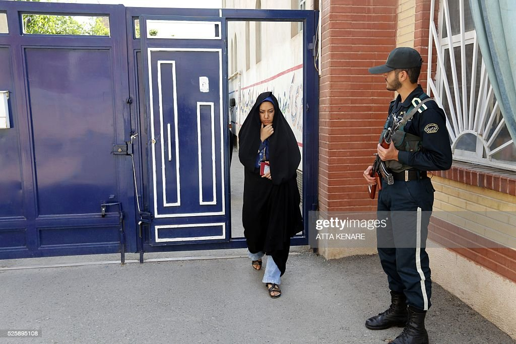 An Iranian woman arrives to cast her vote in the second round of parliamentary elections at a polling station in the town of Robat Karim, some 40 kms southwest of the capital Tehran, on April 29, 2016. Iranians started voting in second round elections for almost a quarter of parliament's seats, the latest political showdown between reformists and conservatives seeking to influence the country's future. Polling stations opened at 8:00 am (0330 GMT) for the ballot which is taking place in 21 provinces, but not Tehran, because no candidate in 68 constituencies managed to win 25 percent of votes cast in initial voting on February 26. Reformists who backed moderate President Hassan Rouhani made big gains in the first round following Iran's implementation of a nuclear deal with world powers, which lifted sanctions blamed for long hobbling the economy. Conservative MPs, including vehement opponents of the West who openly criticised the landmark agreement that reined in Iran's atomic programme, lost dozens of seats and were wiped out in Tehran where reformists won all 30 places in parliament. / AFP / ATTA