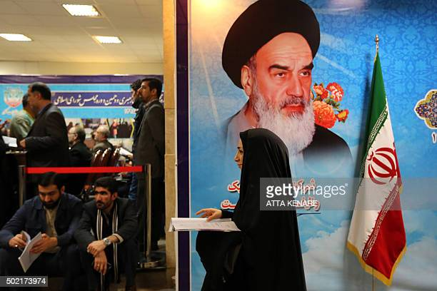 An Iranian woman arrives to register her candidacy for either the upcoming parliamentary or the Assembly of Experts elections at the interior...