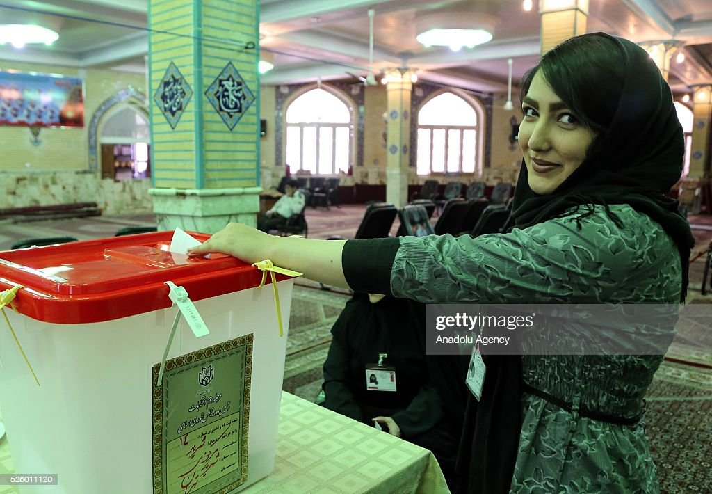 An Iranian woman casts her ballot during a second round of parliamentary elections at a polling station in Shahriar district of Tehran, Iran on April 29, 2016.