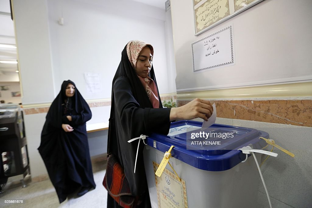 An Iranian woman casts her ballot to vote in the second round of parliamentary elections at a polling station in the town of Robat Karim, some 40 kms southwest of the capital Tehran, on April 29, 2016. Iranians started voting in second round elections for almost a quarter of parliament's seats, the latest political showdown between reformists and conservatives seeking to influence the country's future. Polling stations opened at 8:00 am (0330 GMT) for the ballot which is taking place in 21 provinces, but not Tehran, because no candidate in 68 constituencies managed to win 25 percent of votes cast in initial voting on February 26. Reformists who backed moderate President Hassan Rouhani made big gains in the first round following Iran's implementation of a nuclear deal with world powers, which lifted sanctions blamed for long hobbling the economy. Conservative MPs, including vehement opponents of the West who openly criticised the landmark agreement that reined in Iran's atomic programme, lost dozens of seats and were wiped out in Tehran where reformists won all 30 places in parliament. / AFP / ATTA