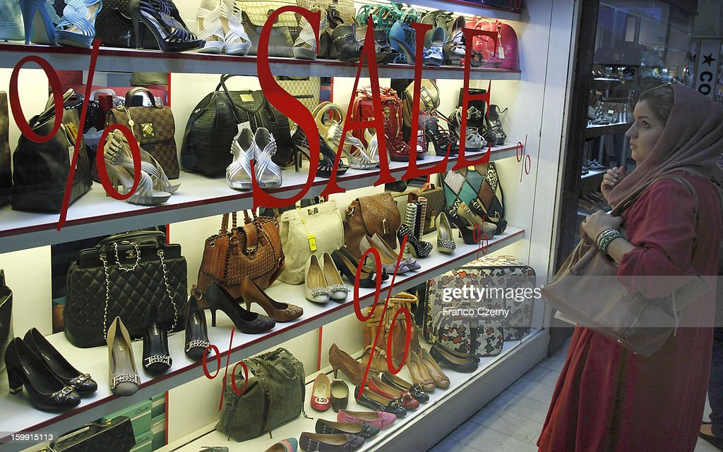 An iranian woman looks at shoes at a store on August 29, 2012 in Tehran, Iran.