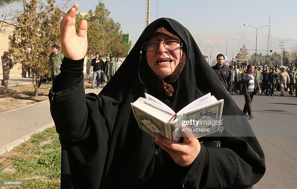 An Iranian woman mourns on February 6, 2016 in the capital Tehran during the funeral of Iran's Revolutionary Guards Brigadier General Mohsen Ghajarian, who was reportedly killed in the northern province of Aleppo in the fight against the Islamic State (IS) jihadist group, Brigadier General Mohsen Ghajarian of the elite Revolutionary Guards was killed in the northern province of Aleppo, according to the Fars news agency, which is close to the Guards. He was advising pro-government forces in the fight against the Islamic State (IS) jihadist group, it reported, without saying when he died. KENARE