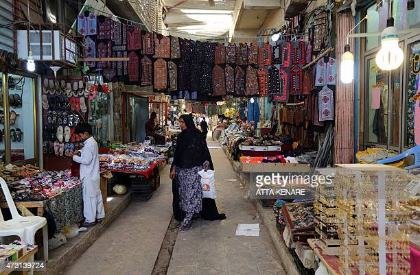 An Iranian woman shops in the old bazaar in the southern Iranian coastal city of Chabahar on May 13 2015 AFP PHOTO/ ATTA KENARE
