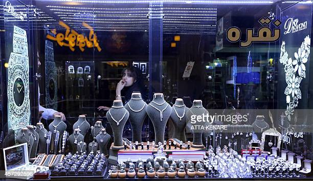 An Iranian woman stands in a shop selling jewelery at the Laleh Park shopping center in Tabriz in Iran's northwestern EastAzerbaijan province on...