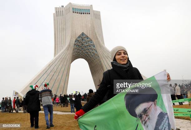 An Iranian woman takes part in a rally marking the anniversary of the 1979 Islamic revolution on February 10 in the capital Tehran Millions of...