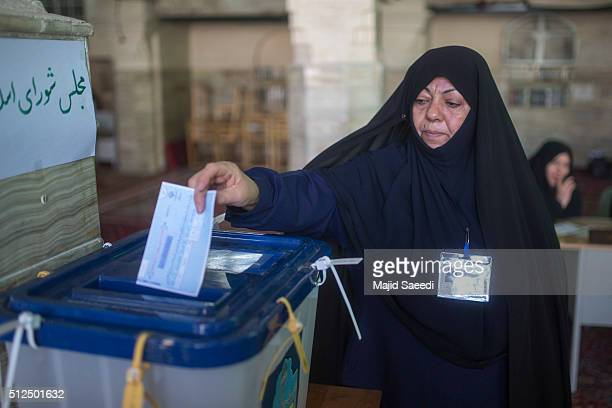 An Iranian woman votes in the parliamentary and Experts Assembly elections at a polling station on February 26 2016 in Qom 125 kilometers south of...