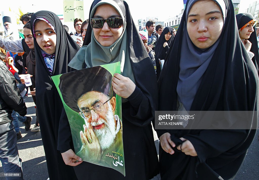 An Iranian women holding a portrait of the founder of Iran's Islamic Republic, Ayatollah Ruhollah Khomeini attends a rally in Tehran's Azadi Square (Freedom Square) to mark the 34th anniversary of the Islamic revolution on February 10, 2013. Hundreds of thousands of people marched in Tehran and other cities chanting 'Death to America' and 'Death to Israel' as Iran celebrated the anniversary of the ousting of the US-backed shah. AFP PHOTO / ATTA KENARE