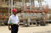 An Iranian worker stands in front of a construction during a visit by Iranian Journalists to the South Pars gas field development phases in the...