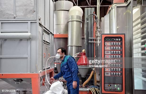 An Iranian worker works at Alumroll Novin Aluminum Factory in Arak Iran on October 6 2016 Alumroll Novin Aluminum Factory employs 750 workers and...