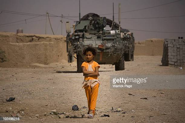 An Iraq girl walks through her village as US Iraqi and Kurdish soldiers conduct a village clearance operation in the hunt for insurgent activity on...