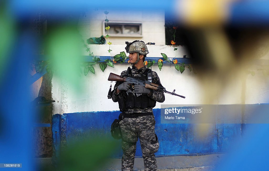 An Iraq Police officer mans a checkpoint decorated with plastic flowers on December 8, 2011 in Baghdad, Iraq. American forces are now in the midst of the final stage of withdrawal from the war-torn country with all troops scheduled to depart by December 31. At least 4,485 U.S. military personnel have died in service in Iraq. According to the Iraq Body Count more than 100,000 Iraqi civilians have died from war-related violence.