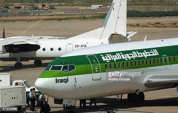 An Iraqi Airways Boeing 737 sits on the tarmac at Baghdad International Airport September 18 2004 Baghdad Iraq National carrier Iraqi Airways...