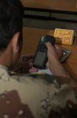 A new Iraqi Army second lieutenant learns how to use a handheld global positioning satellite receiver at Iraqi Army Forward Operating Base Khameis in Diyala province, Iraq.