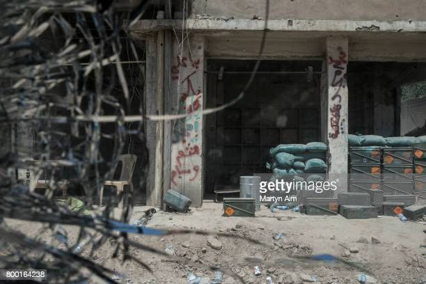 An Iraqi Army position with piles of ammunition and sandbags viewed through the bulletcracked window of a humvee on June 23 2017 in the frontline...