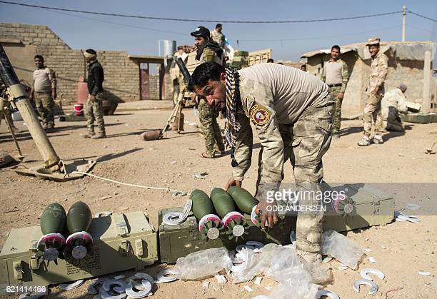 An Iraqi army soldier from the 9th armoured division prepares mortars to be fired from their position in the area of Ali Rash adjacent to the eastern...