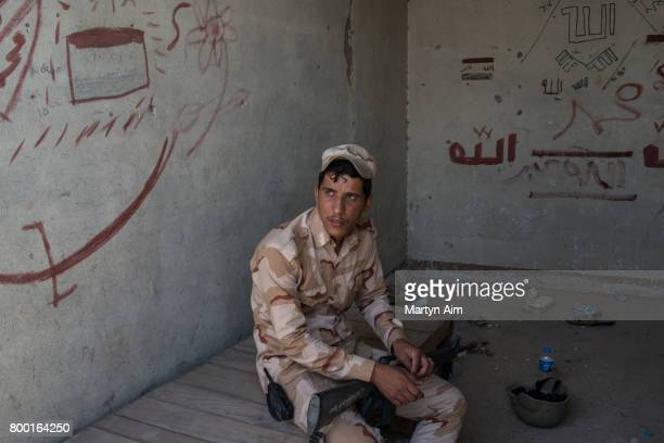 An Iraqi Army soldier is seen on the frontline neighbourhood of Tal Aptar on June 23 2017 which borders the Islamic State occupied Old City of west...