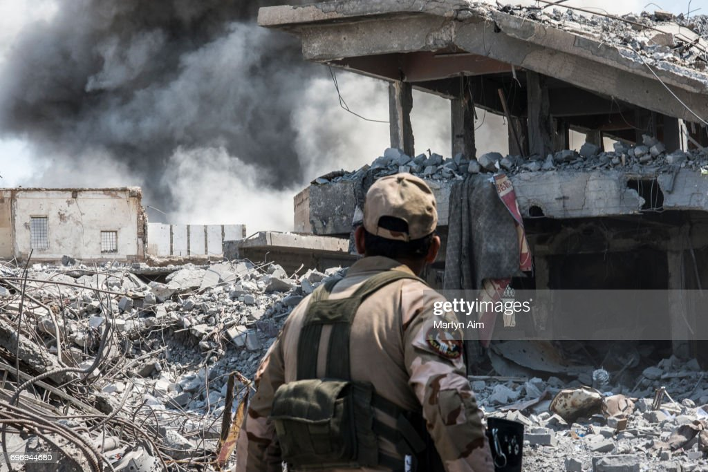 An Iraqi Army soldier looks at an Iraqi forces airstrike which targeted an Islamic State sniper position June 17, 2017 in al-Shifa, the last district of west Mosul under Islamic State control. IS snipers, as well as car and suicide bomb attacks continue to hinder the Iraqi forces efforts to retake the final district. A series of airstrikes by Iraqi helicopter gunships attempted to hit multiple Islamic State sniper positions in al-Shifa today. (Martyn Aim/Getty Images).