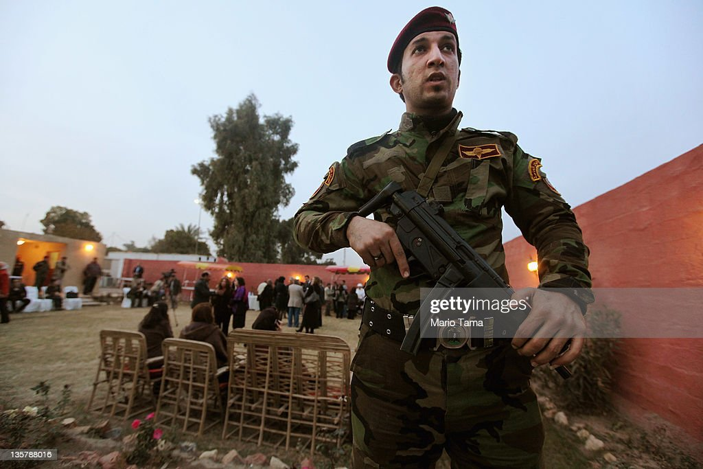 An Iraqi Army special forces soldier keeps watch at a women's art exhibition sponsored by Iraqi Parliament member Safi Asiheil in a posh Baghdad neighborhood on December 14, 2011 in Baghdad, Iraq. Iraq is transitioning nearly nine years after the 2003 U.S. invasion and subsequent occupation. American forces are now in the midst of the final stage of withdrawal from the war-torn country. At least 4,485 U.S. military personnel have died in service in Iraq. According to the Iraq Body Count, more than 100,000 Iraqi civilians have died from war-related violence.