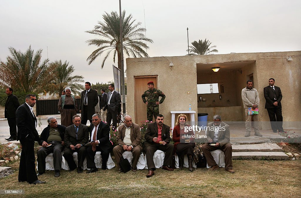 An Iraqi Army special forces soldier (C) keeps watch at a women's art exhibition sponsored by Iraqi Parliament member Safi Asiheil in a posh Baghdad neighborhood on December 14, 2011 in Baghdad, Iraq. Iraq is transitioning nearly nine years after the 2003 U.S. invasion and subsequent occupation. American forces are now in the midst of the final stage of withdrawal from the war-torn country. At least 4,485 U.S. military personnel have died in service in Iraq. According to the Iraq Body Count, more than 100,000 Iraqi civilians have died from war-related violence.