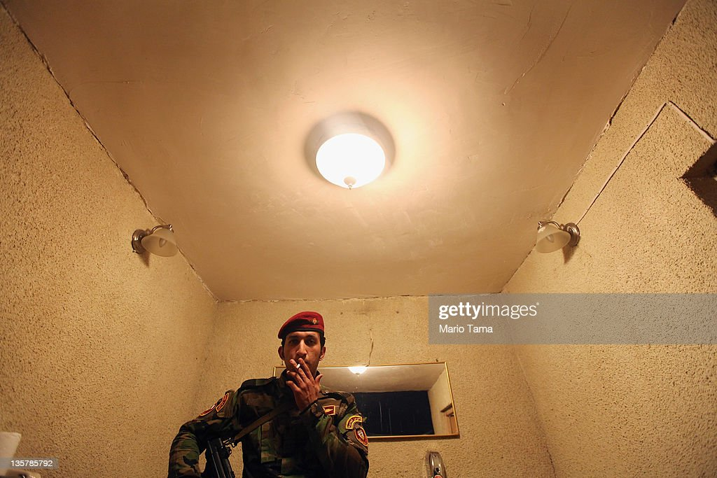 An Iraqi Army special forces soldier smokes outside a women's art exhibition sponsored by Iraqi Parliament member Safi Asiheil in a posh Baghdad neighborhood on December 14, 2011 in Baghdad, Iraq. Iraq is transitioning nearly nine years after the 2003 U.S. invasion and subsequent occupation. American forces are now in the midst of the final stage of withdrawal from the war-torn country. At least 4,485 U.S. military personnel have died in service in Iraq. According to the Iraq Body Count, more than 100,000 Iraqi civilians have died from war-related violence.