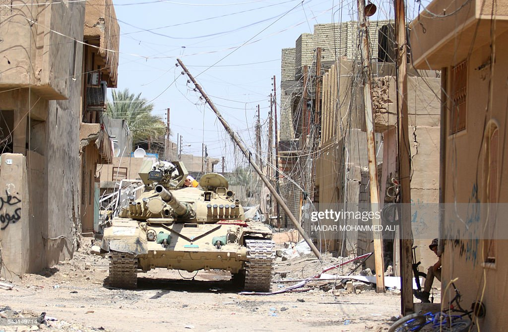 An Iraqi army tank is seen in Fallujah, 50 kilometres (30 miles) from the capital Baghdad, after Iraqi forces retook the embattled city from the Islamic State group on June 26, 2016. Iraqi Prime Minister Haider al-Abadi urged all Iraqis to celebrate the recapture of Fallujah by the security forces and vowed the national flag would be raised in Mosul soon. While the battle has been won, Iraq still faces a major humanitarian crisis in its aftermath, with tens of thousands of people who fled the fighting desperately in need of assistance in the searing summer heat. ALI