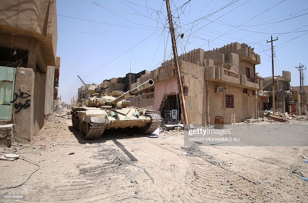 An Iraqi army tank is seen in Fallujah, 50 kilometres (30 miles) from the capital Baghdad, after forces retook the embattled city from the Islamic State group on June 26, 2016. Iraqi Prime Minister Haider al-Abadi urged all Iraqis to celebrate the recapture of Fallujah by the security forces and vowed the national flag would be raised in Mosul soon. While the battle has been won, Iraq still faces a major humanitarian crisis in its aftermath, with tens of thousands of people who fled the fighting desperately in need of assistance in the searing summer heat. ALI