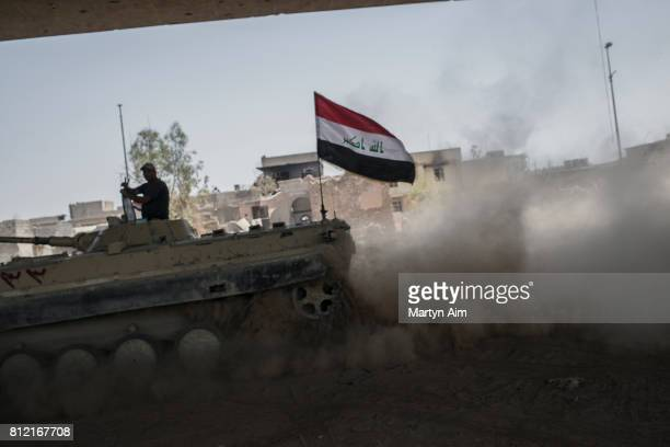 An Iraqi Army tank on the bank of the Tigris River where they fight Islamic State militants who occupy the last section of the Old City district on...