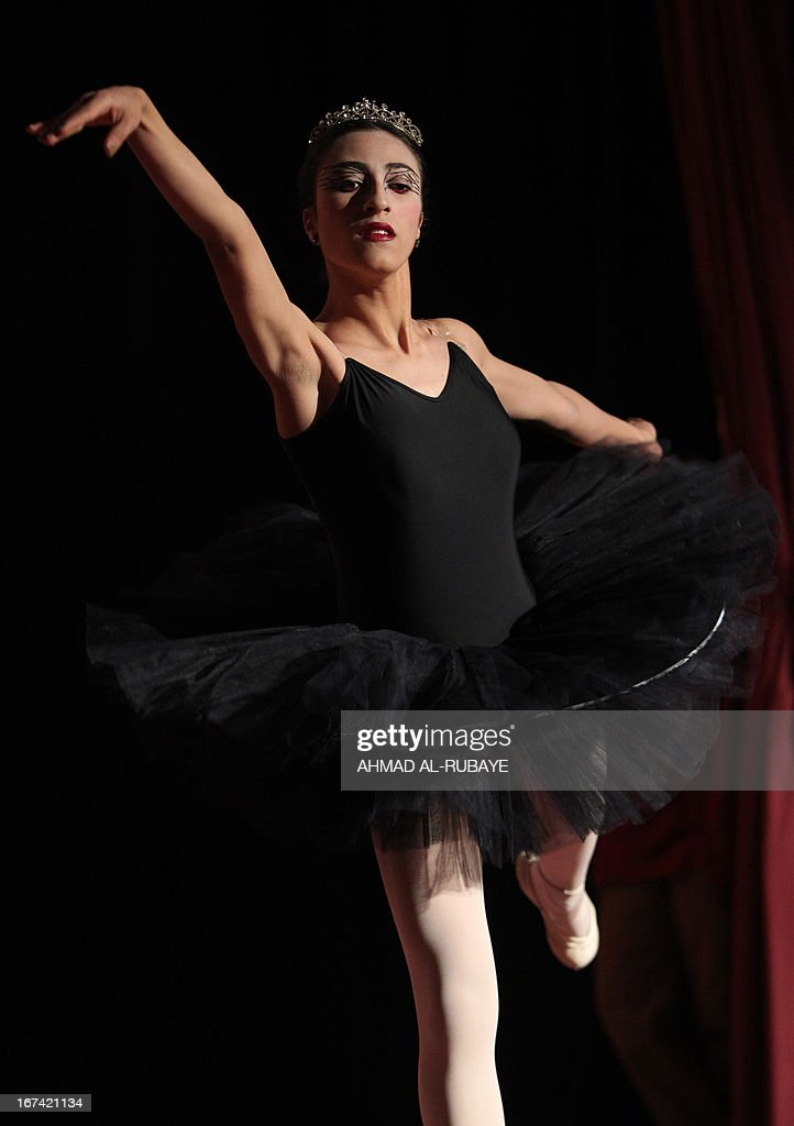 An Iraqi ballet dancer from the ballet and music school, performs during their annual production that marks the end of the school year, at al-Ribat hall theatre in central Baghdad on April 25, 2013.
