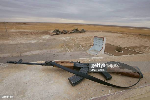 An Iraqi border guard's AK47 rests on the roof of a border fort next to the berm which seperates Iraq from Syria October 31 2003 just west of Sinjar...