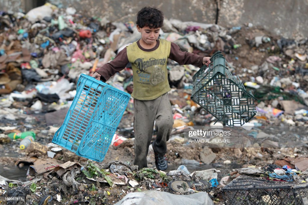 An Iraqi boy collects plastic boxes from a garbage dump on the outskirts of Baghdad's impoverished district of Sadr City, January 30, 2013. Around a quarter of Iraq's population are estimated by the country's Planning Ministry to live in poverty, and many survive in vast refuge dumps where they search for subsistence, either via using disposed goods or finding items that can be handed to recycling plants for money.