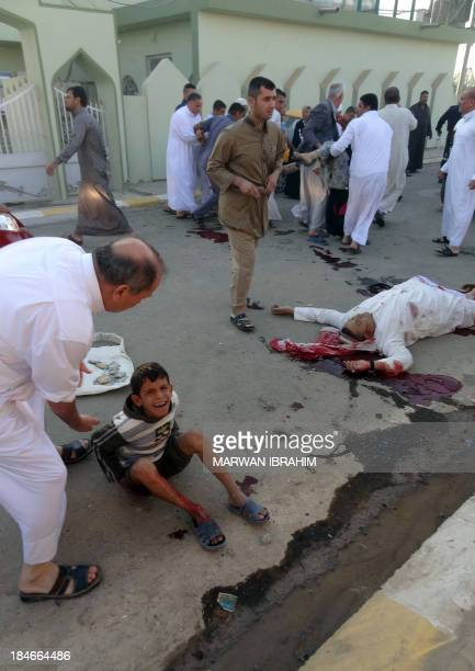 An Iraqi boy cries at the scene of a car bomb attack after it exploded as worshippers left a Sunni mosque after prayers marking the start of the Eid...