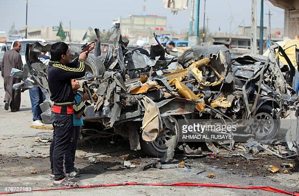 An Iraqi boy fires a toy gun at the site of a car bomb explosion in Sadr City in eastern Baghdad on March 5 2014 Nine bombings mainly targeting...