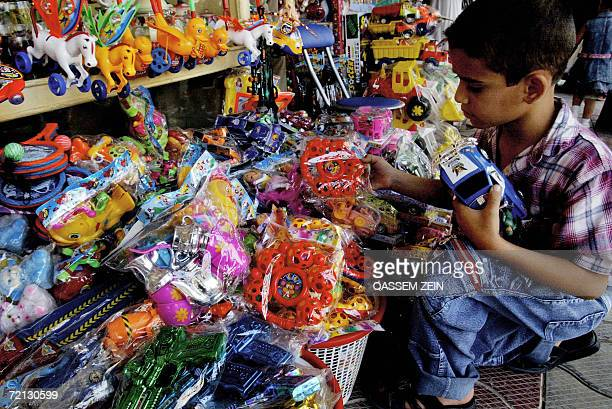 An Iraqi boy picksup toys at a popular market in the holy city of Najaf south of Baghdad 10 October 2006 A bomb exploded outside a bakery in western...