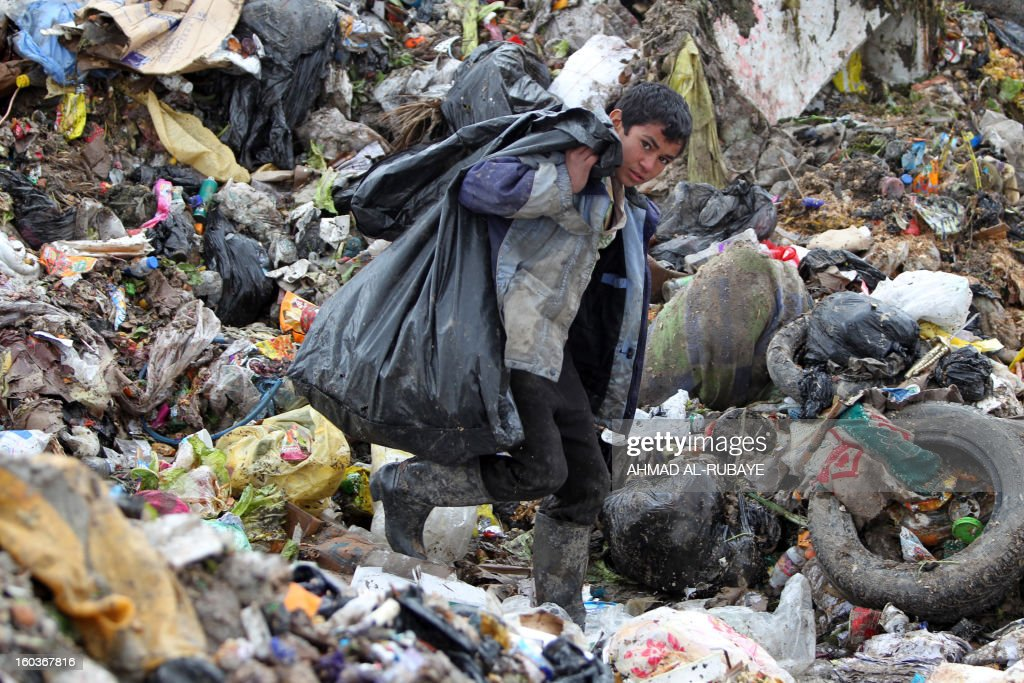 An Iraqi boy searches for plastic bottles in a garbage dump on the outskirts of Baghdad's impoverished district of Sadr City, January 30, 2013. Around a quarter of Iraq's population are estimated by the country's Planning Ministry to live in poverty, and many survive in vast refuge dumps where they search for subsistence, either via using disposed goods or finding items that can be handed to recycling plants for money.