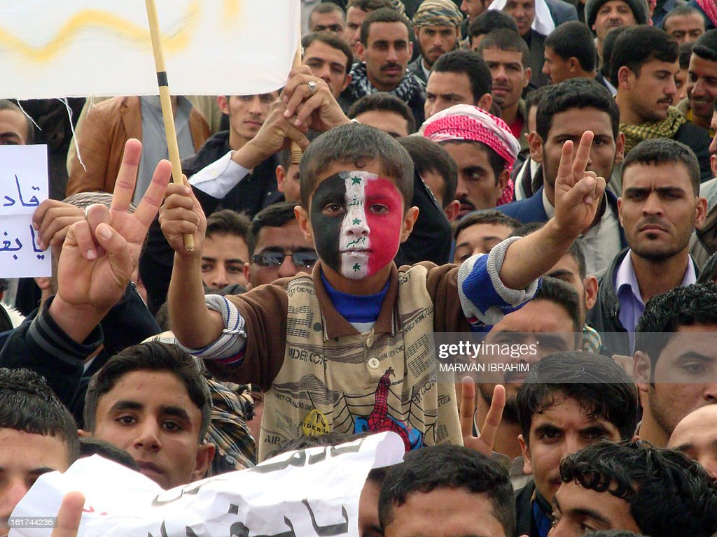 An Iraqi boy, whose face is made up with the national flag, flashes the sign of victory during a rallye following the Friday's prayers to call for the government's fall on February 15, 2013 in Hawijah near the ethnically mixed city of Kirkuk. The protests began after weekly Muslim prayers in Mosul, Samarra, Kirkuk, Baquba, Ramadi and Fallujah -- all predominantly Sunni -- as well as Sunni-majority areas of Baghdad under heavy security as the central government has voiced fears the rallies had been infiltrated by militants.