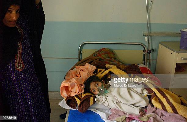 An Iraqi child lays in a hospital bed at the Samawa Maternity and Children's Hospital 170 miles south of Baghdad February 12 2004 in Samawa Iraq...