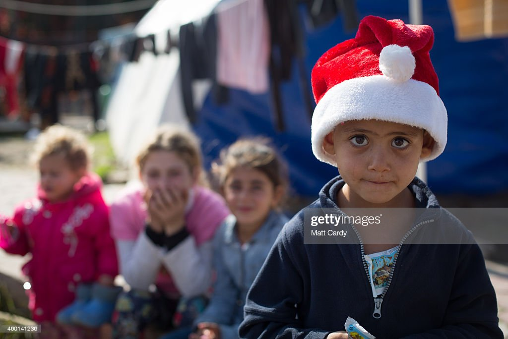 An Iraqi Christian child wears a Santa hat as he plays in the grounds of Mar Elias Catholic Church, in Ankawa, that has now become home to hundreds of Iraqi Christians who were forced to flee their homes as the Islamic State advanced earlier this year, on December 7, 2014 in Erbil, Iraq. Although the autonomous Kurdistan region of Northern Iraq was already a refuge for an estimated 250,000 Syrian refugees, since the Islamic State began its onslaught on Iraq in June, Kurdistan has also taken in a more than one and a half million displaced people. Many have been placed in purpose-built refugee camps but the huge numbers mean thousands of others are forced to live in un-finished buildings or inadequate, makeshift shelters and as winter in the region closes in, there are growing concerns for the welfare of the refugees who, while their homes are still in ISIL controlled territory, have no realistic prospect of returning to them.