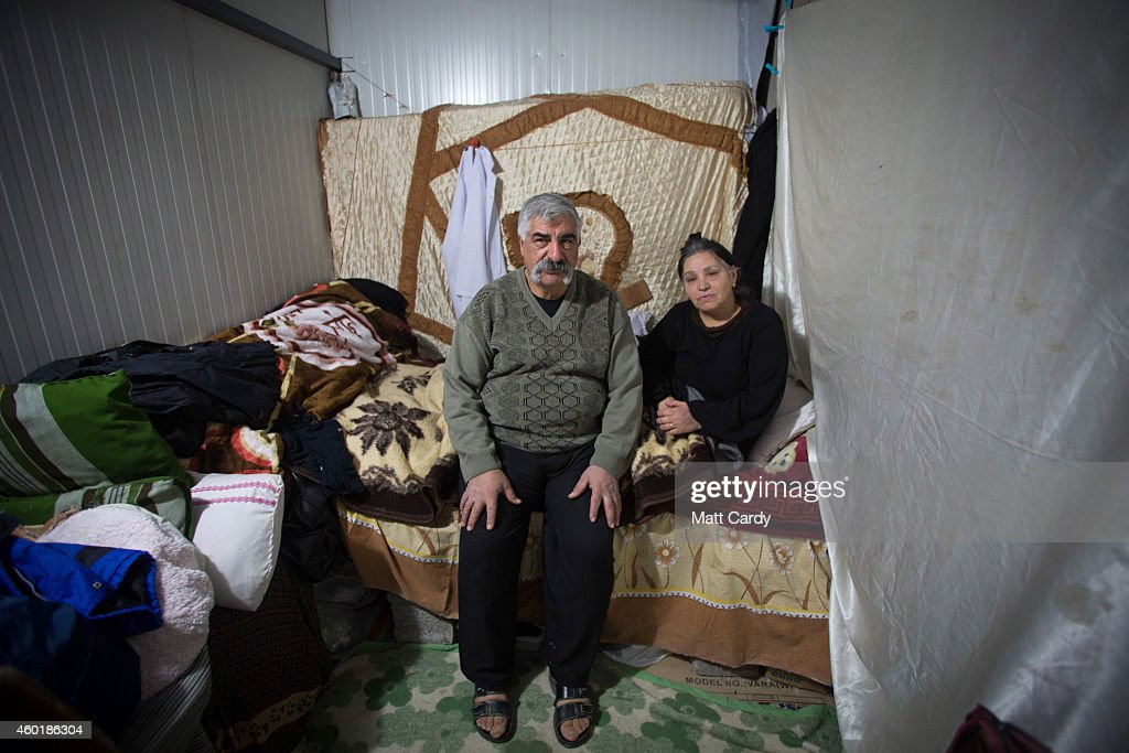 An Iraqi Christian couple, who fled from their home because of Islamic State's advance earlier this year, pose for a photograph inside their shelter constructed in the unfinished Ankawa Shopping Mall which is now home to hundreds of displaced Iraqi Christians on December 8, 2014 in Erbil, Iraq. Although the autonomous Kurdistan region in northern Iraq was already a refuge for an estimated 250,000 Syrian refugees, since the Islamic State began its onslaught on Iraq in June, Kurdistan has also taken in a more than one and a half million displaced people. Many have been placed in purpose-built refugee camps but the huge numbers mean thousands of others are forced to live in un-finished buildings or inadequate, makeshift shelters and as winter in the region closes in, there are growing concerns for the welfare of the refugees who, while their homes are still in ISIL controlled territory, have no realistic prospect of returning to them.