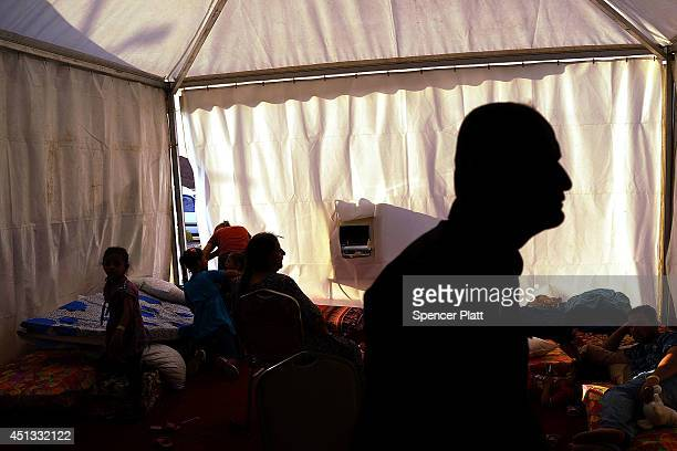 An Iraqi Christian family live in a tent at a displacement camp for Christians after having to flee their district on June 26 2014 in Erbil IraqTens...